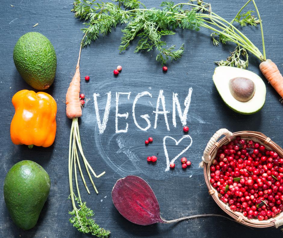 vegan on chalk board with vegetables around
